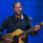 Jack Johnson smiles to the crowd during his show at Darling's Waterfront Pavilion in Bangor Wednesday.