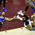 Cleveland Cavaliers forward LeBron James (23) falls down while driving to the basket against Golden State Warriors guard Stephen Curry (30) during the fourth quarter in game three of the 2017 NBA Finals at Quicken Loans Arena. Mandatory Credit: David Richard-USA TODAY Sports