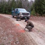 A Maine Forest Ranger collects evidence on a property abuse case in October 2014.