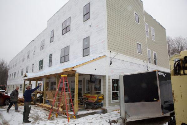 Workmen building a 24-unit Avesta Housing project site in Gorham last year.