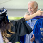 Jaritza Arleen Abreu rushes to hug former Vice President Joseph R. Biden before receiving her Bachelor of Arts Degree from Colby College.