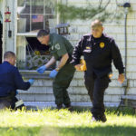 The Maine State Police evidence response team surveyed the scene where 54-year-old Mark Ellis was killed after a more than 12-hour standoff with police at his home in Orrington on Wednesday.