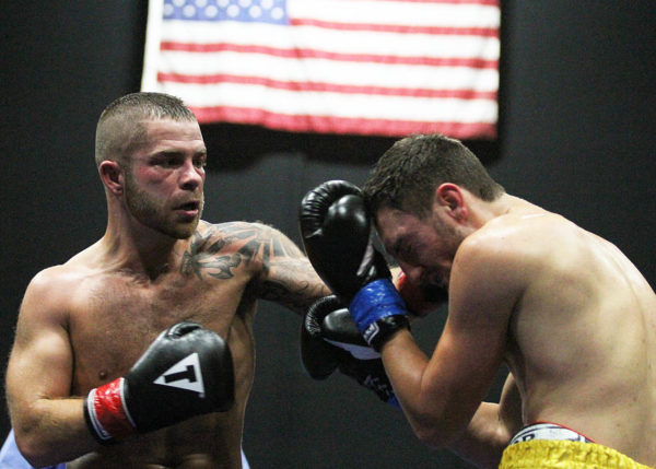 Brandon Berry (left) wins the Northeast Junior Welterweight title over Eric Palmer in 2014.