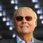 Actor Adam West poses for photographers at a ceremony where he received a star on the Hollywood Walk of Fame in Los Angeles, April 5, 2012.