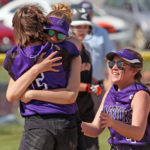 Southern Aroostook's Makaelyn Porter (partially obscured) hugs teammate Kylie Vining as Katelyn Stevens (right) joins the celebration after Southern Aroostook's 10-9 victory over Ashland in the Class D North quarterfinals. The Warriors play Penobscot Valley of Howland in Brewer on Tuesday for the regional title.