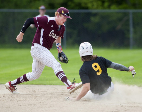 Old Town's Ethan Stoddard (right) slides safely to second past Orono's Jackson Coutts during their baseball game in Old Town in May.