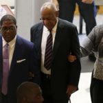 Andrew Wyatt, left, Bill Cosby, center, and his wife, Camille Cosby, right, enter the Montgomery County Courthouse in Norristown, Pa. on June 12, 2017. Cosby is on trial for sexual assault.