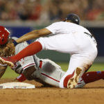 Philadelphia's Howie Kendrick (47) steals second base as Boston shortstop Xander Bogaerts applies the tag during the fifth inning at Fenway Park in Boston. Greg M. Cooper   USA TODAY Sports