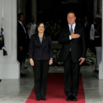 Taiwan's President Tsai Ing-wen listens with her counterpart Panama's Juan Carlos Varela to the national anthem during a welcome ceremony before a meeting at the Presidential Palace in Panama City, Panama June 27, 2016.