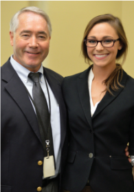 Department of Corrections Commissioner Joseph Fitzpatrick stands with his daughter Molly Fitzpatrick after she completed certification as a corrections officer as part of a 2015 internship.