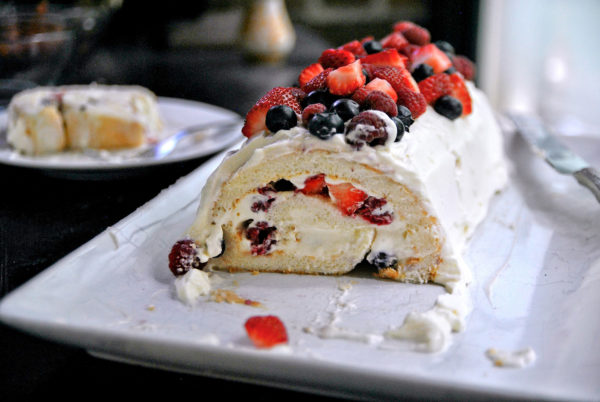 Use a serrated knife to cut the angel food cake roll, and eat it immediately as the cake will dry out.