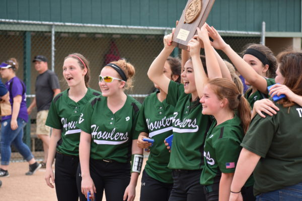 Members of the Penobscot Valley High School softball team hoist the plaque after beating Southern Aroostook of Dyer Brook 3-0 in eight innings on Tuesday for the Class D North championship.