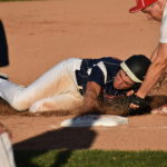 Third baseman Jared Harvey of Fort Fairfield applies the tag to Bangor Christian baserunner Johnathan Cormier during Tuesday's Class D North baseball title game at Mansfield Stadium in Bangor.
