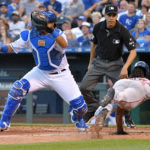 Kansas City's Salvador Perez (left) can't make the tag as Boston's Jackie Bradley Jr. scores in the fourth inning of Tuesday's game at Kauffman Stadium.