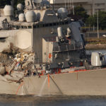 The Arleigh Burke-class guided-missile destroyer USS Fitzgerald, damaged by colliding with a Philippine-flagged merchant vessel, is towed into the U.S. naval base in Yokosuka, south of Tokyo, Japan, on  June 17, 2017.