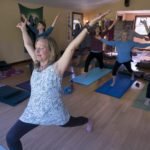 Ayurveda Yoga practitioner and teacher Deborah Keene (left) poses during one of her yoga classes at her studio in Liberty.