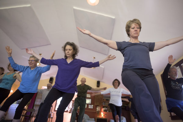 Participants in an Ayurveda Yoga class are led by Deborah Keene at her studio in Liberty.