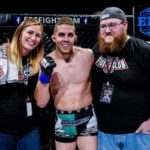 Ray Wood (center) celebrates with his wife (left), Tiana, and friend Mark Heathcote, after winning an EFC III bout in Mulvene, Kansas.