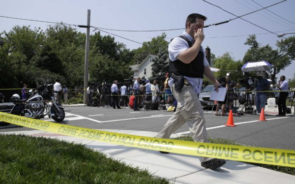 Police investigate a shooting scene after a gunman opened fire on Republican members of Congress during a baseball practice near Washington in Alexandria, Virginia, June 14, 2017.