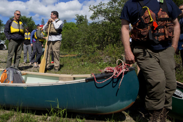U.S. Secretary of the Interior Ryan Zinke (left) prepares to go for a canoe trip during a tour of the Katahdin Woods and Waters National Monument Wednesday. The visit was the start of a four-day visit to New England.