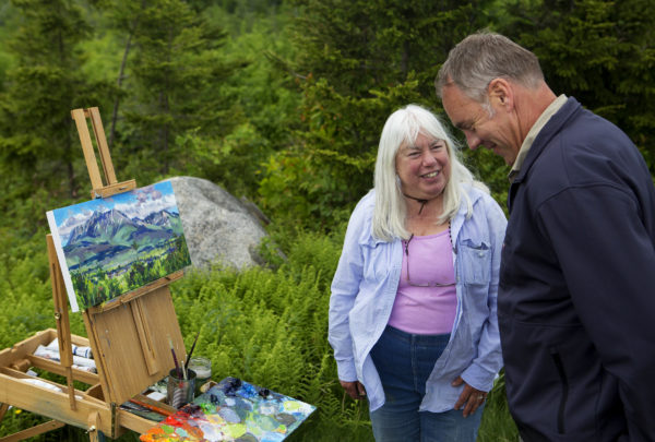U.S. Secretary of the Interior Ryan Zinke (right) chats with Masha Donahue about her painting of Mount Katahdin during a tour of the Katahdin Woods and Waters National Monument Wednesday.