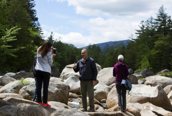 U.S. Secretary of the Interior Ryan Zinke (center) poses for a photo for Heather Swift during a tour of the Katahdin Woods and Waters National Monument Wednesday.