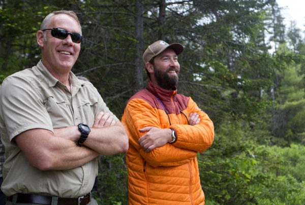 U.S. Secretary of the Interior Ryan Zinke (left) and Lucas St. Clair look over the views during a tour of the Katahdin Woods and Waters National Monument Wednesday.