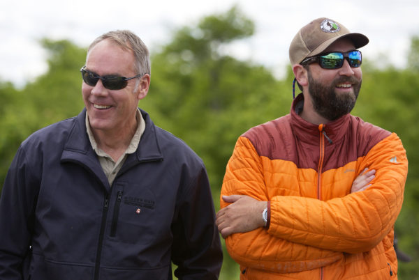 U.S. Secretary of the Interior Ryan Zinke (left) laughs with Lucas St. Clair during a tour of the Katahdin Woods and Waters National Monument Wednesday. The visit was the start of a four-day visit to New England.