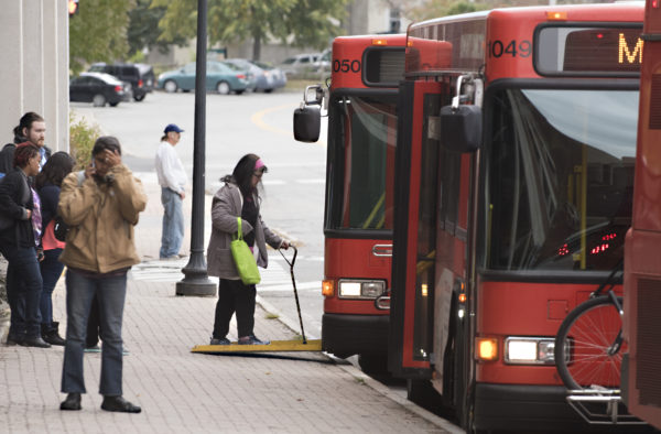 Passengers wait at the bus terminal in Pickering Square in downtown Bangor on Monday afternoon. Expanded service could happen in several years thanks to the arrival of new buses.  Gabor Degre   BDN