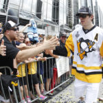 Pittsburgh Penguins center Evgeni Malkin (71) greets fans during the Stanley Cup championship parade and rally in downtown Pittsburgh.
