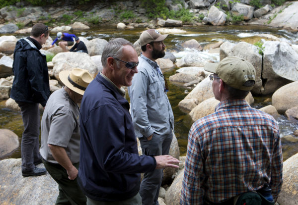 U.S. Secretary of the Interior Ryan Zinke (left) chats with outdoor enthusiasts during a tour of the Katahdin Woods and Waters National Monument Tuesday.