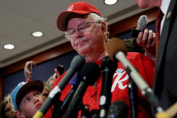 Jack Barton (left), the young son of Rep. Joe Barton (right), manager of the Republican Congressional Baseball team, listens as his father speaks about the shooting that they were both present for in Alexandria, Virginia while addressing the media on Capitol Hill in Washington, U.S., June 14, 2017.