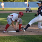Tyler Welch (right) of Bangor Christian scrambles back to third base as Fort Fairfield's Jared Harvey fails to handle the throw from the catcher during their Class D North baseball championship game on Thursday in Bangor.