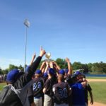 The Searsport baseball team holds its championship trophy aloft after defeating Penobscot Valley 10-2 to win their second straight Class D state championship in 2016.