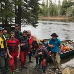 A group of paddlers from UMPI puts in at Bissonette Bridge for a four-day canoe trip on the Allagash River in May.