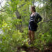 Rachel Borch, 21, stands along an overgrown area of the trail she runs along Alford Lake, much like the section where she was recently attacked by a rabid raccoon while jogging near her home in Hope. The raccoon lunged at her and bit her on the thumb, not letting go. Borch drowned the animal in a puddle.