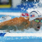 Michael Phelps during the men's 100m butterfly preliminary heats in the U.S. Olympic swimming team trials at CenturyLink Center.