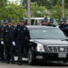 Fryeburg Police officers walk with the vehicle carrying the Desjardins family and the cremated remains of fallen Fryeburg police officer Nathan M. Desjardins following the Law Enforcement Tribute at the Augusta Civic Center on Friday morning where thousands came to honor the fallen officer.