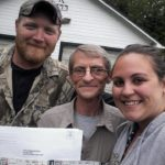 Jim Gleason (center) is shown here with his son-in-law Mike Dill and his daughter Ashly Dill after the woman enlisted an East Millinocket police officer's help to present Gleason with a pair of tickets to the Rod Stewart concert next month at Bangor Waterfront Park.