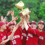 Members of the Bangor baseball team show off their championship trophy after beating Falmouth 4-3 in nine innings to win the Class A state baseball title at Morton Field in Augusta on Saturday.