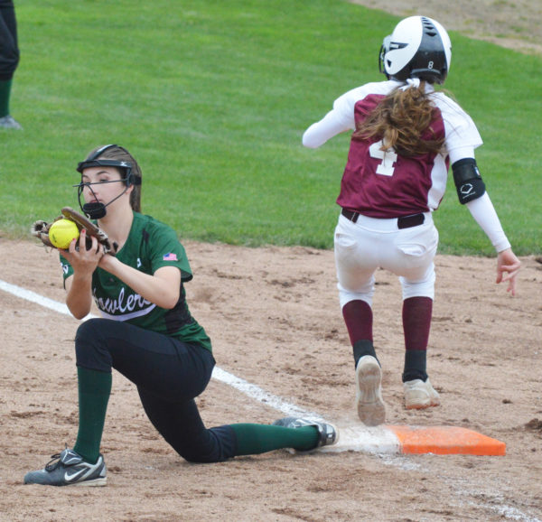 Howlers first baseman Lexi Ireland, left, has her eyes on the ball while retiring Richmond base runner Meranda Martin (4) during the sixth inning of Saturday's State Class D championship game at St. Joseph's College in Standish.