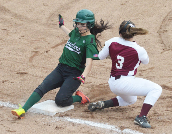 Penobscot Valley's Elizabeth McKinnon, left, slides into third ahead of the tag of Richmond third baseman Camryn Hurley on a steal attempt in the State Class D softball championship game at Standish on Saturday. The Howlers downed the Bobcats, 4-0.