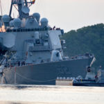 The U.S. Navy Arleigh Burke-class guided-missile destroyer USS Fitzgerald returns to Fleet Activities Yokosuka following a collision with a merchant vessel while operating southwest of Yokosuka, Japan, June 17, 2017.