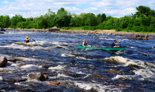 Boaters negotiate one of the rapids during a practice run Wednesday on the Penobscot river from Binette Park in Old Town to the Orono boat landing in preparation for the Penobscot River Whitewater Nationals Regatta.