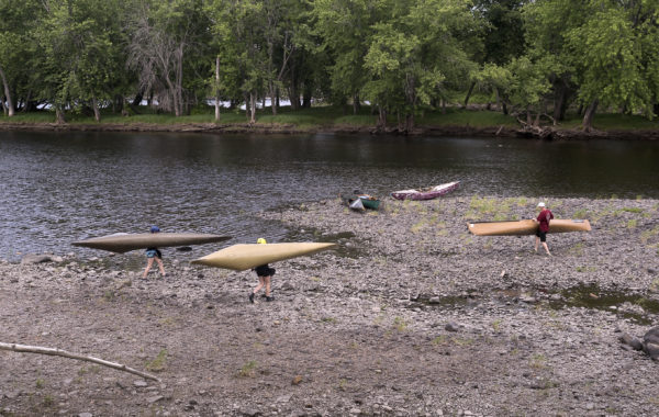 People take their boats down to the water as they were getting ready for a practice run Wednesday on the Penobscot river from Binette Park in Old Town to the Orono boat landing in preparation for the Penobscot River Whitewater Nationals Regatta.
