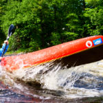 Katie Owen, 14, negotiates one of the rapids during a practice run Wednesday on the Penobscot river from Binette Park in Old Town to the Orono boat landing in preparation for the Penobscot River Whitewater Nationals Regatta.
