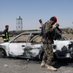 Afghan security forces inspect the exterior of a car after a suicide bomb blast in Gardez, Paktia Province, Afghanistan, June 18, 2017.