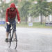 A man rides a bike through the pouring rain on Marginal Way in Portland, Sept. 30, 2015.