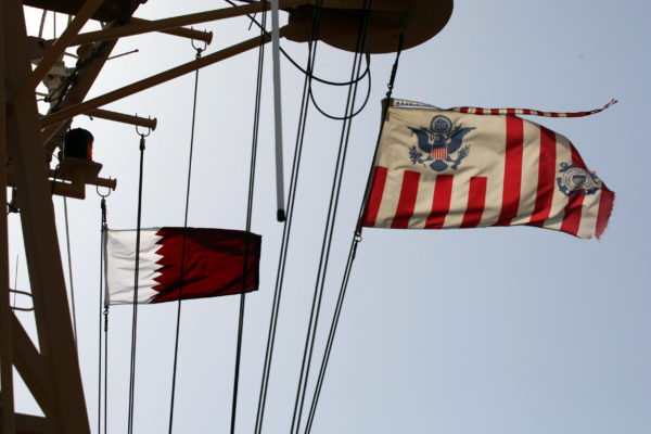 Qatari and a U.S. Coast Guard flags flutter during a joint naval exercise by US and Qatar troops in the Arabian Gulf, Qatar, June 16, 2017.