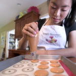 Jaelin Roberts, 14,  of Bangor makes macarons at her home.  After much experimentation with the process, Roberts started a business last fall selling the sweets. Each little macaron is hand made in small batches by Jaelin with a little help from her mother Joan Roberts.